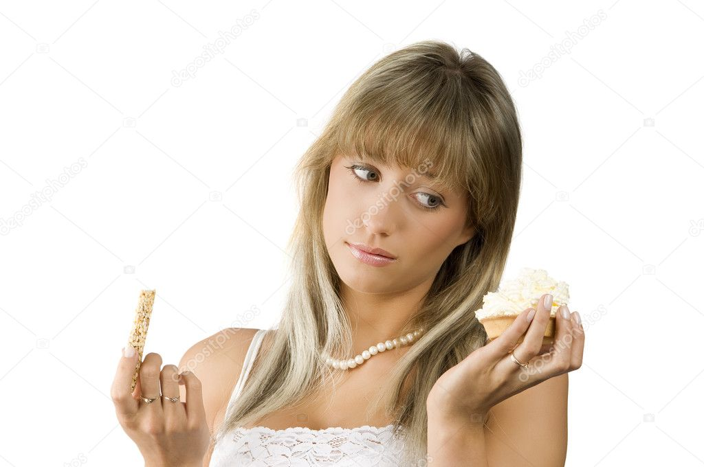 Beautiful girl in hesitation to choose between sweet or diet food — Stock Photo #4705362