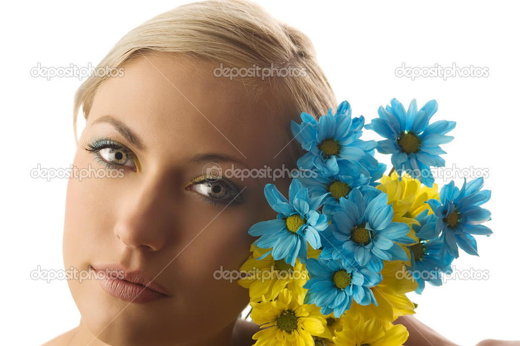 Nice beauty portrait of pretty blond girl with blue and yellow daisy and colored makeup  Stock Photo #4705791