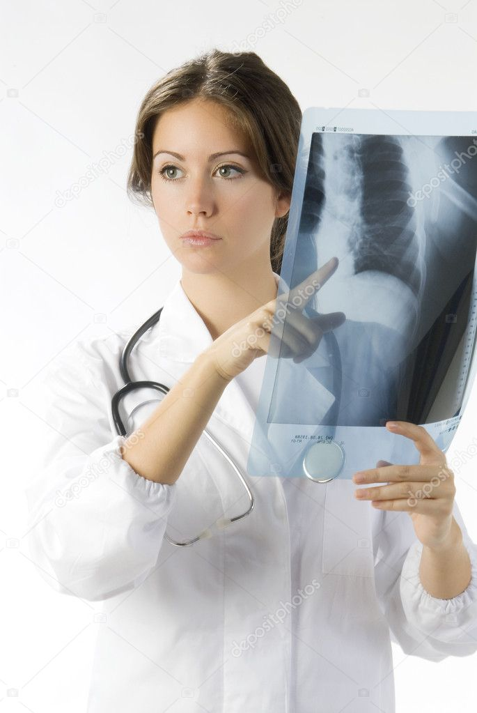 Young and beautiful doctor looking at x-ray — Stock Photo #4706662