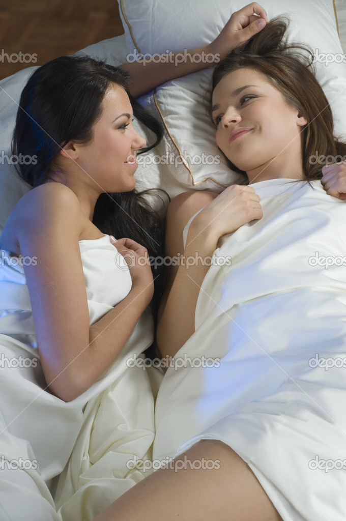 Two sweet girls friend in the same bed talking  Stock Photo #4706845