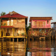 Caribbean houses over the water — Stock Photo