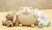 Toy puppy, leveret and doll — Stock Photo