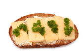 Sandwich of whole bread and cheese and greens — Stock Photo