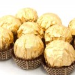 Chocolates in a gold wrapper — Stock Photo
