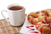 Donuts and a cup of tea — Stock Photo