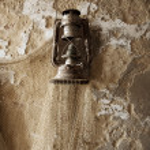 Old fashioned lantern with fisherman web — Stock Photo