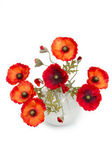 The image of a bouquet of artificial poppies in a vase, isolated — Stock Photo