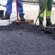 Asphalt Worker - Stock Photo