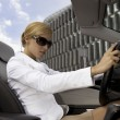 Blonde businesswoman in a car — Stock Photo #4399159