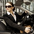 Stock Photo: Businesswomdriving car