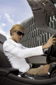 Blonde businesswoman in a car — Stock Photo