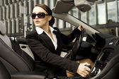 Businesswoman driving a car — 图库照片