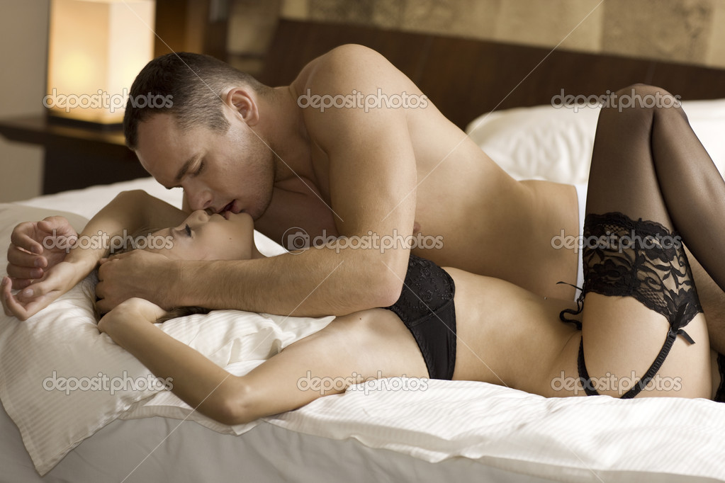Intimate young couple during foreplay in bed  Stock Photo #4398727