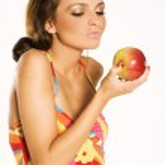 Beautiful woman holding a apple — Stock Photo #4533528