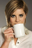 Blondie with white cup — Stockfoto