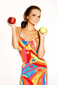 Beautiful woman holding a apple — Stock Photo