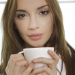 Portrait of cute teenage girl with cup of coffee — Stock Photo #4751315