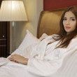 Beautiful woman on a bed and pillow — Stock Photo #4751326