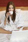 Young adult brunette woman starting day — Stock Photo