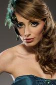 Beautiful blond model in blue lucid dress — Stock Photo