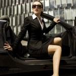 Businesswoman in a cabrio — Stock Photo #4809495