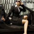 Stock Photo: Businesswomin cabrio