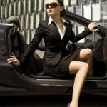 Businesswoman in a cabrio — Stock Photo #4809500