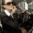 Stock Photo: Businesswoman in a cabrio