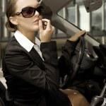Businesswoman in a cabrio — Stock Photo #4809507