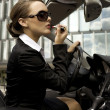 Businesswoman in a cabrio - 图库照片