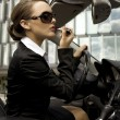 Businesswoman in a cabrio - Stock Photo