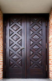 Door of an old building decorated ornately — Stock Photo