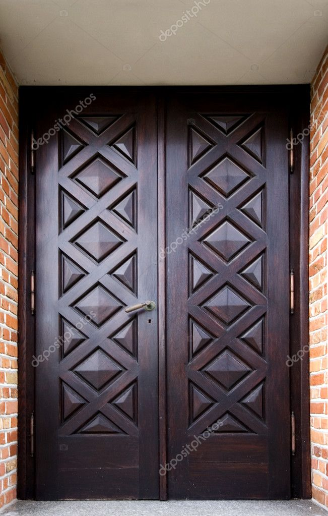 Door of an old building decorated ornately  Stock Photo #4808179