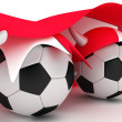 Two soccer balls hold Austria flag - Stock Photo