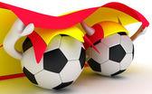Two soccer balls hold Spain flag — Stock Photo
