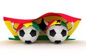 Two soccer balls hold Ghana flag — Stock Photo