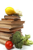 Old cookbooks with several vegetables — Stock Photo