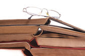 Glasses on old study-books — Stock Photo
