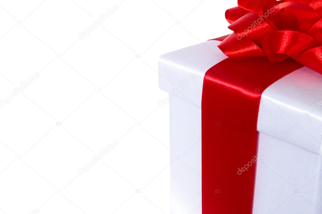White gift box with red ribbon and bow isolated on the white background — Stock Photo #4466583