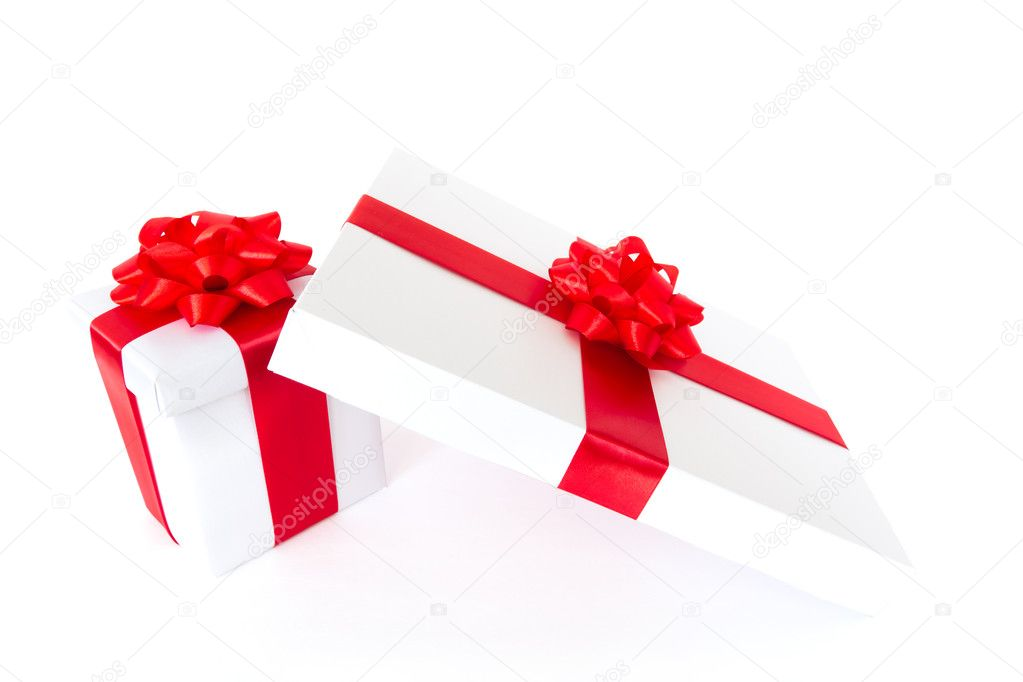 Gift boxes with red ribbon and bow isolated on the white background — Stock Photo #4466614
