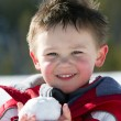 Boy with snowball — Stock Photo