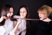 Three young beautiful women in studio — Stock Photo