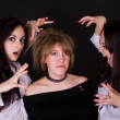 Three young beautiful women in studio — Stock Photo