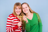 Two beautiful girls with candies — Stock Photo