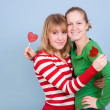 Two beautiful girls with red candies — Stock Photo #4639163