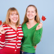 Two beautiful girls with red candies — Stock Photo #4639191