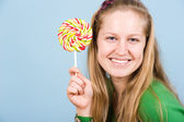 Beautiful young woman with long hair with candy — Stock Photo