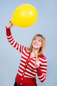 Girl with brackets with toy balloon and candy — Stock Photo