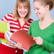 Two young blond women with books — Stock Photo #4665642