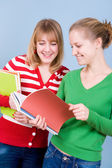 Two young blond women with books — Stock Photo